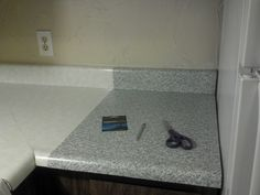 Update Countertops with Dollar Store Contact Paper