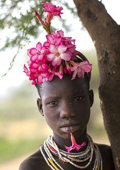 Eric Lafforgue  www.ericlafforgue.com Kid With Flowers Decorations, Korcho, Omo Valley, Ethiopia