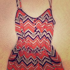 Cute Romper! Worn once. Has pockets. It's orange white and purplish/navy/black BeBop Dresses
