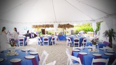 Purple and blue linens for a tented beach wedding