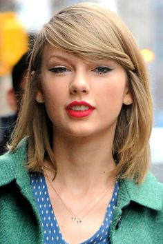 22 of Taylor Swift's Best Curly, Straight + Short Hairstyles via Brit + Co.
