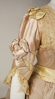 Evening dressEvening dress Design House: House of Worth (French, 1858–1956) Designer: Jean-Philippe Worth (French, 1856–1926) Date: 1887–89 Culture: French Medium: silk Dimensions: Length at CB (a): 9 1/4 in. (23.5 cm) Length at CB (b): 60 in. (152.4 cm) Credit Line: Gift of Orme Wilson and R. Thornton Wilson, in memory of their mother, Mrs. Caroline Schermerhorn Astor Wilson, 1949