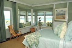 An amazing beach house master bedroom. I love the colors - so relaxing. Mrs. Phoebe Howard.