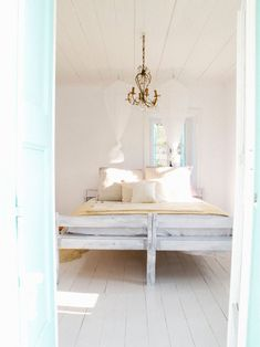 I want this bedroom!  Natural fibres, natural tones, with white and a touch of light turquoise, perfect!  www.funkyfabrix.com.au