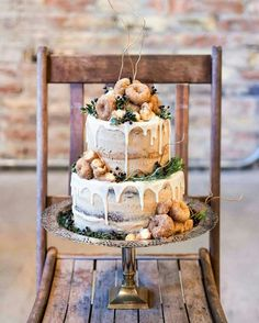 Donut Wedding Cake by Emily with The Pear Blossom. Bottom tier is a rich chocolate cake with warm cinnamon pumpkin undertones, and the top tier is a delightful apple spice cake. All frosted in a cinnamon brown sugar buttercream, dripped with glaze, and topped with cinnamon and sugar donuts!