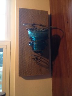 Insulator sconces, I have them on both sides of my window over my kitchen sink. I love them!! Next are wine bottle sconces!!