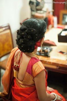 "The quintessential ""Khopa""(Stylish hair bun )for the bengali bride"