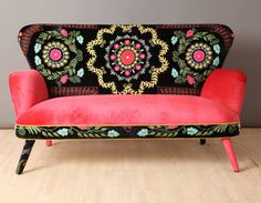 Handmade two seats sofa upholstered with high quality vintage Uzbek Suzani and pink velvet fabrics. Beautiful combination of the lovely colors.