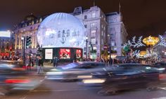 Festive fulcrum … traffic swirls around the base of the Eros snow globe.