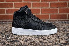 buy online 411a5 bdc74 This new colorway of the Nike Air Force 1 High features a woven upper in  all-black with white accents.