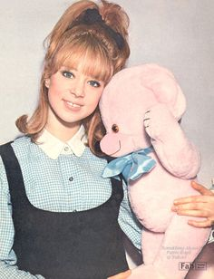 """Pattie Boyd FABULOUS Pin-up! Circa April 1964 - Pattie Boyd, top London model and new girlfriend of Beatle George Harrison, posing for FABULOUS magazine at her Chelsea flat in Oakley Street. Pattie shared the small one bedroom flat with her pink teddy bear and roomie, Mary Bee (since December 1963). Pattie recalled that it: …""""was a horrid place with a pokey kitchen, and we seemed to live on hot dogs most of the time."""" But, with her modelling career zooming Pattie and Mary ..."""