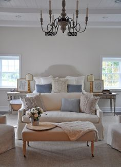 beautiful bedroom. linen and blue. with seating area.