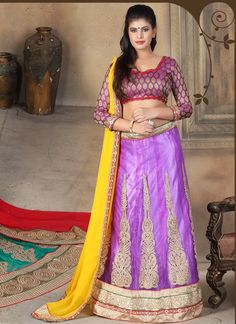 We have ensemble a symphony of enchanting piece to restyle your senses. Be the dazzling diva clad in this lavender net a line lehenga choli with exquisite designs and patterns. This attire is encrafte...