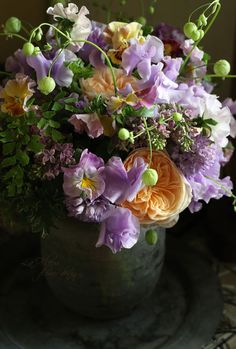 gorgeous palette. Sweet peas, lilac, English garden rose, pansy, maidenhair fern, scented geranium leaf and ? vine.