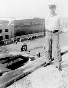 """An August 10-13, 1938 photo of an unidentified man with the Focke-Wolfe Fw 200 S-1""""Brandenburg"""" Condor in front of a Floyd Bennett hangar.  Long Island"""