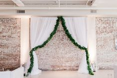 Draping and greenery, a beautiful combination! | Photo: Taylor Dane Photography | Florals: Forever Wild Floral Co | BridgeStreet Gallery & Loft | Birmingham Wedding Venue