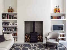 Wood burner fireplace and storage by Charles Barclay Architects Living Room Shelves, New Living Room, Interior Design Living Room, Home And Living, Living Room Designs, Log Burner Living Room, Wood Burner Fireplace, Paint Fireplace, Fireplace Shelves