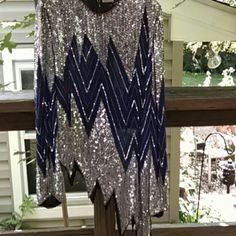 """Vintage Sequined top..pristine *Vintage* Silver sequined/beaded over sheer royal blue silk long sleeve top. Made in India for Saks Fifth Avenue. Non symmetrical hem. No missing sequins or pulls. In excellent, wearable condition. 24"""" sleeve length from shoulder. Inseam from under arm on short side = 12"""". Inseam on longer side = 24"""". Saks Fifth Avenue Tops"""