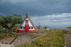 Santana which is short for Santa Ana (meaning Saint Anne) is a town along the northern coast of the island of Madeira. Home to the Palheiros; Thatched House, St Anne, Coast, Poster, Cabin, Island, Park, House Styles, Portugal