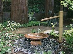 Bamboo, copper and polished stones create a beautiful water feature. From DIY Network