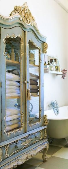 Love the idea of refinishing and repurposing china cabinets and armoires for use as storage in bathrooms.