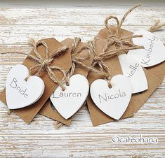 SALE Personalised Wedding Heart Favours Hand Painted Rustic Chic Wooden Hearts Decor Name Place Tags pack of 10 Ivory white or colour von CafeOhana auf Etsy https://www.etsy.com/de/listing/204041021/sale-personalised-wedding-heart-favours