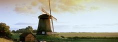 Beautiful Countryside Landscape with a Windmill in the Netherlands.