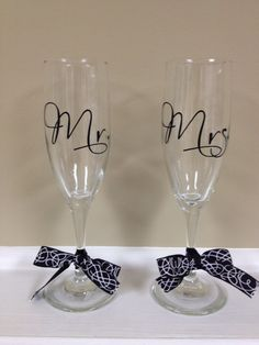 Mr & Mrs Champagne Flutes by AllieGatorGifts on Etsy, $15.00, I could make these for cheaper though!
