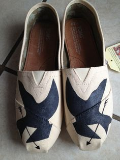Mockingjay Painted TOMS. My nerd side is showing a bit here but I SO want these