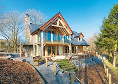 oak frame home in Wales with veranda and glass balustrade