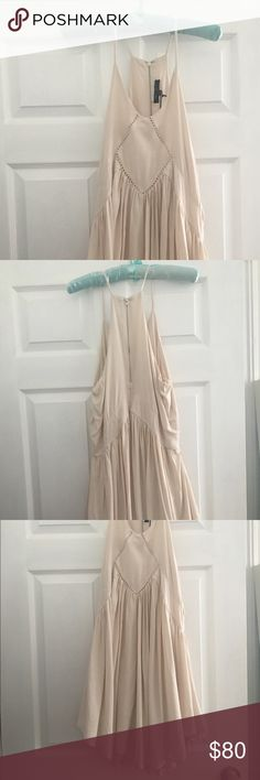 NWT sundress Canvas colored Romeo and Juliet dress. Pretty for festivals with flattering top and flowy on bottom. Great movement. Slip underneath attached. Fits 2-6. Romeo & Juliet Couture Dresses
