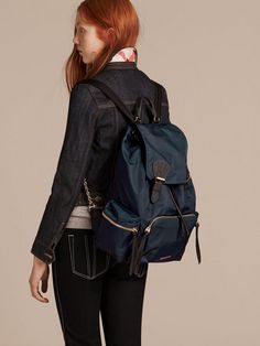 8d0f29b4ccf A lightweight showerproof Burberry rucksack with cushioned and polished  metal chain shoulder straps and leather trims