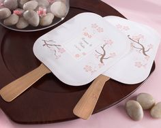 These beautiful cherry blossom fans are a great choice in a favors. Decorated with delicate cherry blossom design and a bamboo handle.