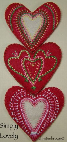 Embroidered hearts by Christen Brown