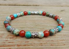 Casual mens beaded bracelet is made with 6mm Carnelian and Imperial Jasper. Very cool. Carnelian Properties: It is said to promote passion, creativity, motivation and self-esteem. It is a healing and