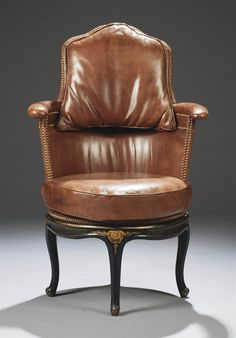 A LOUIS XV STYLE PARCEL-GILT BLACK-PAINTED DESK ARMCHAIR, MADE WITH SOME OLD ELEMENTS.