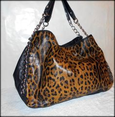 'Steve Madden X-Large Cheetah 'n Chains Hobo Tote – EUC' is going up for auction at  8pm Mon, Apr 14 with a starting bid of $10.