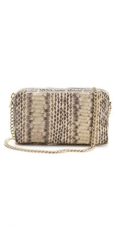 This mini @Loeffler Randall 'Pouchette' snakeskin bag with chain straps is perfect for your essentials $225, get it here: http://rstyle.me/~mdY8