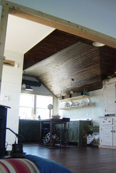 Pine Tongue and Groove Vaulted Ceiling Finished with Dark Stain Tongue And Groove, Dark Stains, River House, Diy Planters, Mid Century House, Vaulting, Stairways, Beautiful Gardens, Restoration