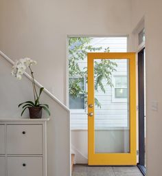 I want this door. Better than divided glass and solid looking. Home Entryway with Yellow Door Frame in Modern House, Remodelista