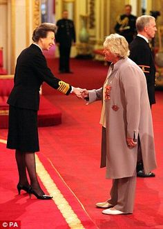 10/14/14.   Dame Laura Davies, from Lyne, is made a Dame Commander of the British Empire by The Princess Royal