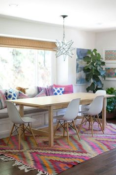 Check out this colorful, ethnic-influenced dining room @dreambookdesigns.com, featuring the NORDEN table!