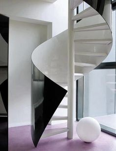 The use of black-and-white on this spiral staircase is masterful.  I'd love it if the globe was also a light!