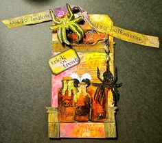 This is my October tag for Tim Holtz 12 tags of 2013