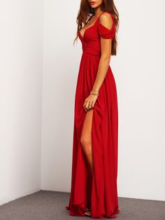 Wine Red Off The Shoulder Maxi Dress. It has a long flowing hemline with a sexy side split. Red Carpet approved this attention getting silhouette is definitely screaming Hollywood glam.