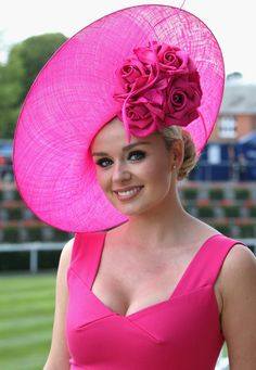 Welsh opera singer Katherine Jenkins poses for a photograph in her hat as she arrives on the first day of Royal Ascot 2009 at Ascot Racecour...
