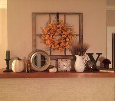 Fall mantel Hobby Lobby- pillar and candle, pumpkins, mirror, clock, shock of wheat, Y. TJ Maxx- orange bottle, owl. Target- ceramic pitcher, maroon flower bunch.  Jo Ann's- wreath.