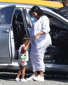 Finally! A heavily pregnant Kim Kardashian gave her swollen feet a break on Monday, Oct. 11, by ditching her heels and throwing on a pair of comfortable sneakers for a family outing at a wine safari in Malibu, California. See the pic here!