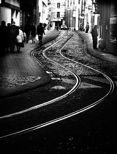 RONALD COOLEY: Tram tracks snake their way through the multi-textured street…