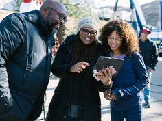 First assistant director Michael J. Moore (from left), director Ava DuVernay and Storm Reid laugh on the set of 'A Wrinkle in Time.'